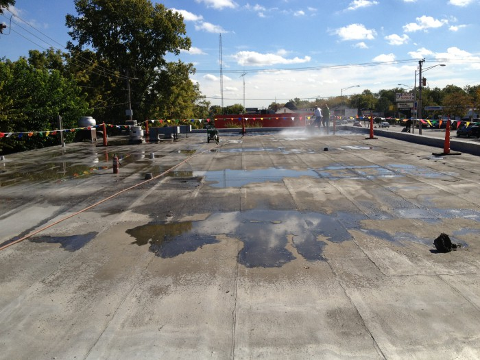 It was important to pressure wash the entire roof to remove any dirt or debris prior to applying coating.
